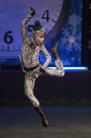 age 10: DNEPROPETROVSK, UKRAINE - DECEMBER 27: Kirill Solovyev, age 10 years old, performs dance Leopard on December 27, 2012 in Dnepropetrovsk, Ukraine Editorial