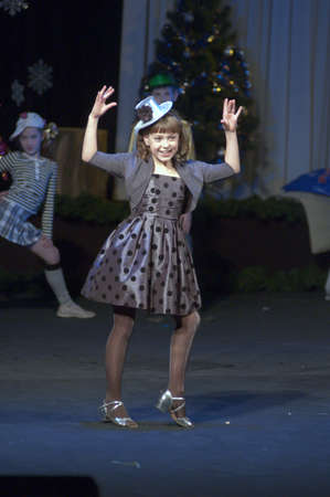 27 years old: DNEPROPETROVSK, UKRAINE - DECEMBER 27: Masha Tarasenko, age 9 years old, performs Mary Poppins on December 27, 2012 in Dnepropetrovsk, Ukraine
