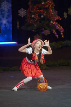 27 years old: DNEPROPETROVSK, UKRAINE - DECEMBER 27: Nastya Goncharuk, age 9 years old, performs Little Red Riding Hood on December 27, 2012 in Dnepropetrovsk, Ukraine Editorial