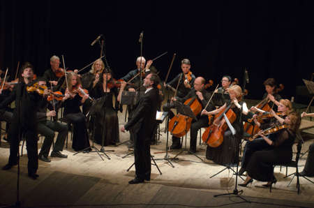 arm bands: DNIPRO, UKRAINE - JUNE 6, 2016: FOUR SEASONS Chamber Orchestra - main conductor Dmitry Logvin perform at the State Russian Drama Theatre