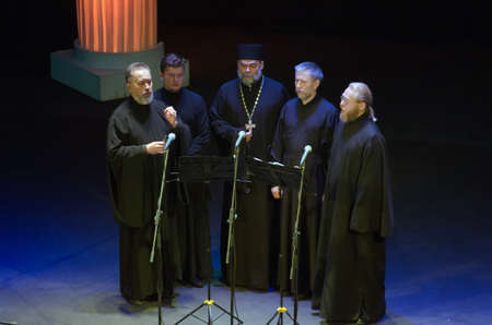 vibrate: DNIPROPETROVSK, UKRAINE - MARCH  21, 2016: Members of the Ensemble singing ancient Candlemas  perform at the State Russian Drama Theatre. Editorial