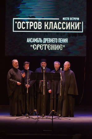 DNIPROPETROVSK, UKRAINE - MARCH  21, 2016: Members of the Ensemble singing ancient Candlemas  perform at the State Russian Drama Theatre. Editorial