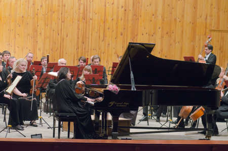 symphonic: DNIPROPETROVSK, UKRAINE - JANUARY 16, 2016: Members of the Symphonic Orchestra perform at the Conservatory.