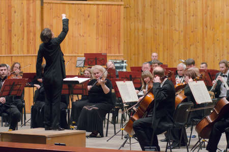 symphonic: DNIPROPETROVSK, UKRAINE - JANUARY 16, 2016: Members of the Symphonic Orchestra - main conductor Natalia Ponomarchuk perform at the Conservatory.