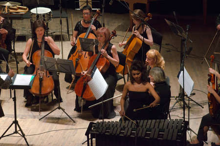 helen: DNIPROPETROVSK, UKRAINE - JUNE 22, 2015: Famous performer Helen Shabelsky (vibraphone) and  FOUR SEASONS Chamber Orchestra - main conductor Dmitry Logvin perform at the State Russian Drama Theatre