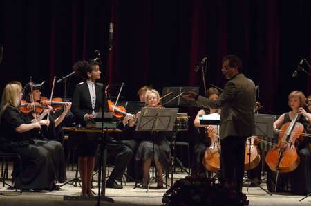 DNIPROPETROVSK, UKRAINE - JUNE 22, 2015: Famous performer Helen Shabelsky and  FOUR SEASONS Chamber Orchestra - main conductor Dmitry Logvin perform at the State Russian Drama Theatre