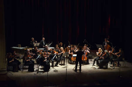 DNIPROPETROVSK, UKRAINE - JUNE 22, 2015:  FOUR SEASONS Chamber Orchestra - main conductor Dmitry Logvin perform at the State Russian Drama Theatre Editorial