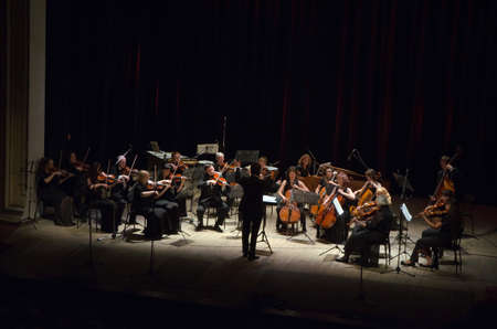 vibrate: DNIPROPETROVSK, UKRAINE - JUNE 22, 2015:  FOUR SEASONS Chamber Orchestra - main conductor Dmitry Logvin perform at the State Russian Drama Theatre Editorial