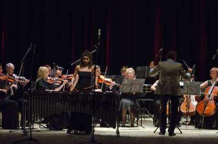 helen: DNIPROPETROVSK, UKRAINE - JUNE 22, 2015: Famous performer Helen Shabelsky (marimba) and  FOUR SEASONS Chamber Orchestra - main conductor Dmitry Logvin perform at the State Russian Drama Theatre