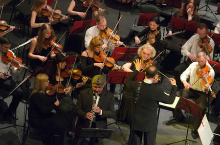 vibrate: DNIPROPETROVSK, UKRAINE - MAY 25: Famous clarinettist Dancho Radevski and Academic Symphony Orchestra - main conductor Grigor Palikarov perform on May 25, 2015 in Dnipropetrovsk, Ukraine