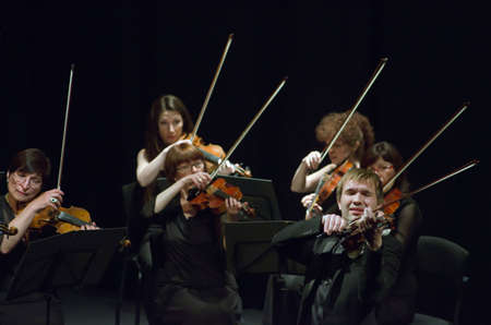 DNIPROPETROVSK, UKRAINE - MAY 14: Famous violinist Ostap Shutko and members of the Symphony Orchestra perform at the State Russian Drama Theatre on May 14, 2015 in Dnipropetrovsk, Ukraine