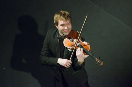 vibrate: DNIPROPETROVSK, UKRAINE - MAY 14: Famous violinist Ostap Shutko performs at the State Russian Drama Theatre on May 14, 2015 in Dnipropetrovsk, Ukraine