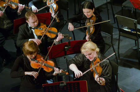 symphonic: DNIPROPETROVSK, UKRAINE - FEBRUARY 9: Members of the Symphonic Orchestra perform at the State Russian Drama Theatre on February 9, 2015 in Dnipropetrovsk, Ukraine