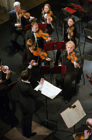 symphonic: DNIPROPETROVSK, UKRAINE - FEBRUARY 9: Members of the Symphonic Orchestra - main conductor Natalia Ponomarchuk perform at the State Russian Drama Theatre on Feb. 9, 2015 in Dnipropetrovsk, Ukraine