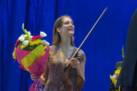 vibrate: DNIPRO, UKRAINE - SEPTEMBER  26, 2016: Violinist Henja Semmler - member of theOberon Trio performs at the Philharmonic.