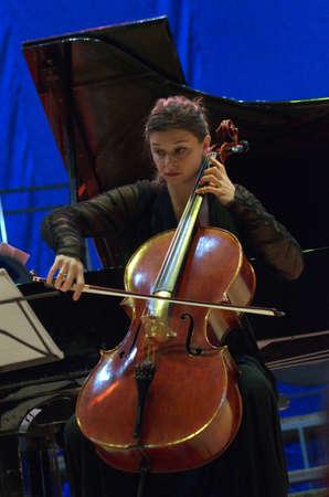 trio: DNIPRO, UKRAINE - SEPTEMBER  26, 2016: Cellist Antoinette Emanuilova- member of the Oberon Trio performs at the Philharmonic. Editorial