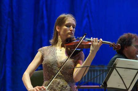 dnipro: DNIPRO, UKRAINE - SEPTEMBER  26, 2016: Violinist Henja Semmler - member of theOberon Trio performs at the Philharmonic.