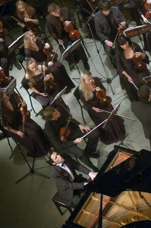 pianista: DNEPROPETROVSK, UKRAINE - NOVEMBER 11: Pianist Alexander Romanovsky and Youth Symphony Orchestra FESTIVAL perform music of  Prokofiev on November 11, 2013 in Dnepropetrovsk, Ukraine