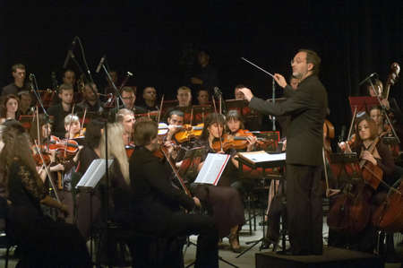 vibrate: DNEPROPETROVSK, UKRAINE - NOVEMBER 11: Youth Symphony Orchestra FESTIVAL - main conductor Dmitry Logvin perform music of  Prokofiev and Shostakovich on November 11, 2013 in Dnepropetrovsk, Ukraine