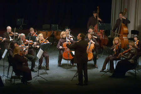 DNEPROPETROVSK, UKRAINE - MARCH 4: Four seasons Chamber Orchestra - main conductor Dmitry Logvin perform music of Telemann on March 4, 2013 in Dnepropetrovsk, Ukraine Editorial