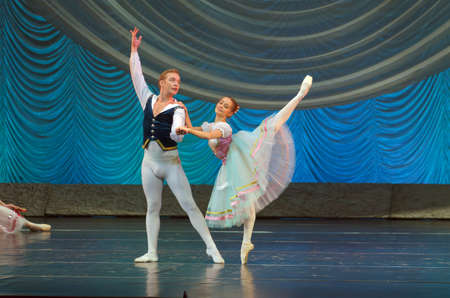 balletic: DNIPRO, UKRAINE - OCTOBER 15, 2016: Degage ballet performed by members of the Dnipropetrovsk State Opera and Ballet Theatre.