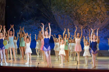 27 years old: DNIPROPETROVSK, UKRAINE - JUNE 27, 2015: Unidentified girls, ages 7-15 years old, perform Home at State Opera and Ballet Theatre.