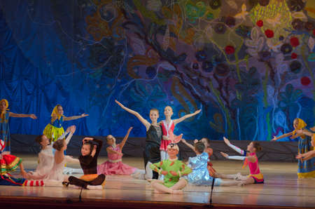27 years old: DNIPROPETROVSK, UKRAINE - JUNE 27, 2015: Unidentified girls, ages 7-15 years old, perform A toy shop at State Opera and Ballet Theatre.