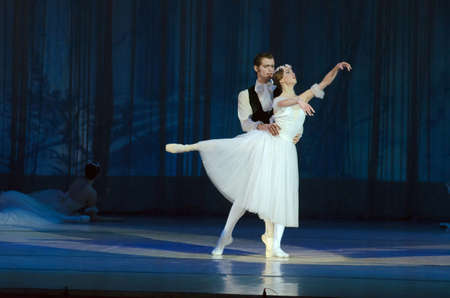 balletic: DNIPROPETROVSK, UKRAINE - MAY 30: Dancers Elena Saltykov and Eugene Kuchvar perform CHOPINIANA at State Opera and Ballet Theatre on May 30, 2015 in Dnipropetrovsk, Ukraine Editorial