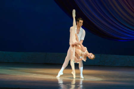 balletic: DNIPROPETROVSK, UKRAINE - MAY 30: Dancers Elena Pechenyuk and Dmitry Omelchenko perform BALANCHINE at State Opera and Ballet Theatre on May 30, 2015 in Dnipropetrovsk, Ukraine