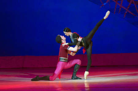 balletic: DNIPROPETROVSK, UKRAINE - MAY 30: Dancers Catherine Shmigelsky and Eugene Kuchvar perform THE LEGEND OF LOVE at State Opera and Ballet Theatre on May 30, 2015 in Dnipropetrovsk, Ukraine