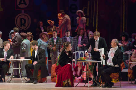 DNIPROPETROVSK, UKRAINE - MAY 21: Members of the Dnipropetrovsk State Opera and Ballet Theatre perform BOHEMIA on May 21, 2015 in Dnipropetrovsk, Ukraine Редакционное