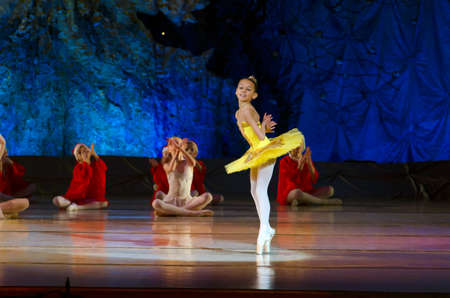 DNIPROPETROVSK, UKRAINE - JANUARY 11: Unidentified Children, ages 7-9 years old, perform Ballet pearls at State Opera and Ballet Theatre on January 11, 2015 in Dnipropetrovsk, Ukraine