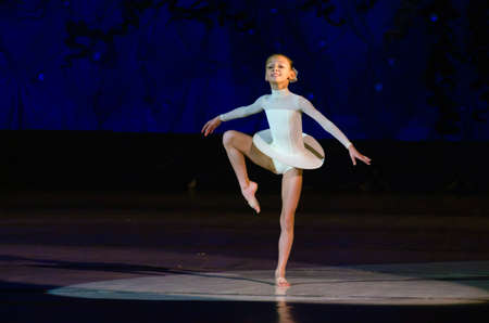 DNIPROPETROVSK, UKRAINE - JANUARY 11: An unidentified girl, age 9 years old, performs Ballet pearls at State Opera and Ballet Theatre on January 11, 2015 in Dnipropetrovsk, Ukraine