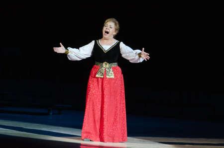vibrate: DNIPROPETROVSK, UKRAINE - DECEMBER 26: Famous singer Zoya Kaipova performs at the State Opera and Ballet Theatre on December 26, 2014 in Dnipropetrovsk, Ukraine