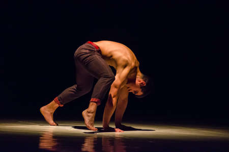 DNIPRO, UKRAINE - JUNE 6, 2017: Dancer Daniil Belkin performs Modern Dance Based on at the State Theater of Drama and Comedy Editöryel
