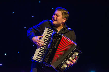 DNIPRO, UKRAINE - SEPTEMBER 23, 2017: Famous accordionist Vladimir Zuban performs Ukrainian folk songs at the Philharmonic.