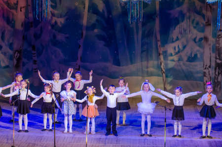 DNIPRO, UKRAINE - DECEMBER 28, 2017: Unidentified children, ages 6-7 years old, perform Christmas tale show at the State  Palace of children and youth. Editorial
