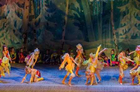 DNIPRO, UKRAINE - DECEMBER 28, 2017: Unidentified children, ages 6-9 years old, perform Christmas tale show at the State Palace of children and youth.