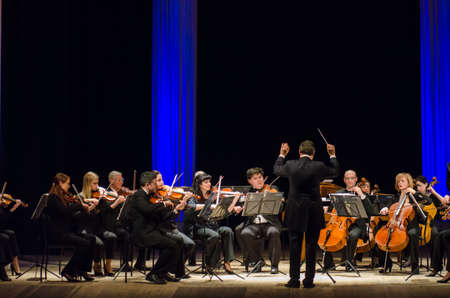 DNIPRO, UKRAINE - MARCH 12, 2018: FOUR SEASONS Chamber Orchestra - main conductor Dmitry Logvin perform at the State Drama Theatre.