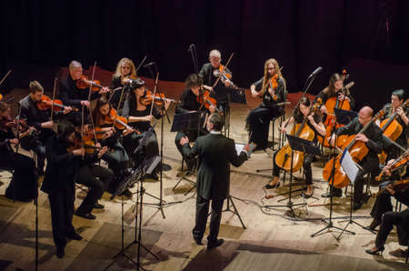 DNIPRO, UKRAINE - OCTOBER 22, 2018: Famous violinist Eugene Kostritsky and members of the FOUR SEASONS Chamber Orchestra - main conductor Dmitry Logvin perform at the State Drama Theatre. Editorial