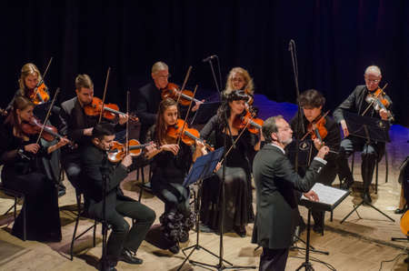 DNIPRO, UKRAINE - OCTOBER 22, 2018: FOUR SEASONS Chamber Orchestra - main conductor Dmitry Logvin perform at the State Drama Theatre.