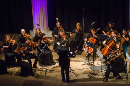DNIPRO, UKRAINE – MARCH 4, 2019: FOUR SEASONS Chamber Orchestra - main conductor Dmitry Logvin perform at the State Drama Theatre. Editorial