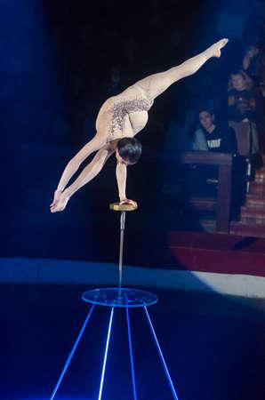 DNIPRO, UKRAINE - DECEMBER 13, 2019:  Plastic equilibrist Victoria Dzyuba performs at the Circus.