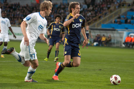 DNEPROPETROVSK, UKRAINE – APRIL 9: Marko Devic of  FC Metalist (R) fights for the ball with Ivan Strinic(L) of FC Dnepr during Uk. Championship match on April 9, 2012 in Dnepropetrovsk, Ukraine