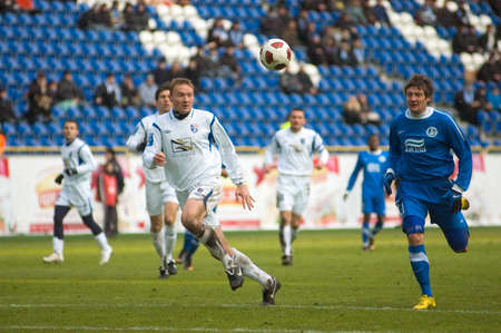 DNEPROPETROVSK, UKRAINE – March, 6:  Seleznyov of  FC Dnipro (R) fights for the ball with Monakhov of FC Tavriya(L)   during their Uk. Championship game on March 6 , 2011 in Dnepropetrovsk.
