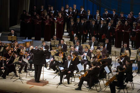 """DNEPROPETROVSK, UKRAINE – DECEMBER 26: """"Christmas Oratorio"""" by metropolitan Hilarion performed by Symphony Orchestra and chorus of the Kharkov Philharmonic on Decemder 26, 2011 in Dnepropetrovsk, Ukraine"""