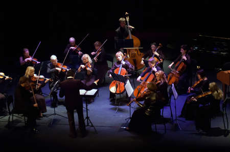 """DNEPROPETROVSK, UKRAINE - OCTOBER 22: """"Four seasons"""" Chamber Orchestra - main conductor Dmitry Logvin perform music of George Frideric Handel on October 22, 2012 in Dnepropetrovsk, Ukraine"""