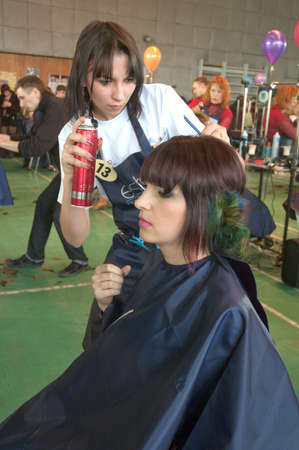 DNEPROPETROVSK, UKRAINE - MARCH 28: Stylist and his model prepar for the Championship on hairdressing, nail aesthetics and make YOUNG TALENTS OF UKRAINE on Mach 28, 2008 in Dnepropetrovsk, Ukraine