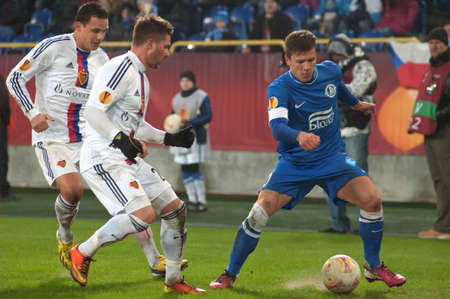 DNIPROPETROVSK, UKRAINE - FEB.21: Yevhen Konoplyanka (R) of FC Dnipro fights for the ball with Markus Steinhofer of FC Basel during the match of  UEFA Europa League on Feb. 21, 2013 in Dnipropetrovsk Editöryel