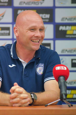 DNIPRO, UKRAINE - JULY 31, 2016: Head Coach of FC Stal Eric van der Meergives an interview after the match of the Premier League FC Dnipro against FC Stal.